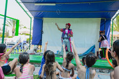 Omer (Beer-Sheva), ISRAEL -Children in swimsuits on the grass and a clown on the summer stage near the pool- July 25, 2015 Royalty Free Stock Photos
