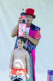Omer (Beer-Sheva), ISRAEL -Clown with a boy shows focus with a bottle of Pepsi-Cola, July 25, 2015 in Israel. Beer-Sheva, ISRAEL -Clown with a boy shows focus Royalty Free Stock Photography