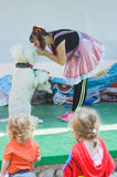 Omer (Beer-Sheva), ISRAEL - Clown woman, white poodle and two children - the viewer back July 25, 2015 in Israel Stock Images