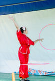 Omer (Beer-Sheva), ISRAEL -The girl in the scarlet kimono spinning hoop against a white screen, July 25, 2015 Stock Images