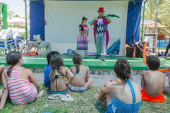 Omer (Beer-Sheva), ISRAEL -Two clowns on stage near the pool in front of children, seen from behind, July 25, 2015 Stock Image