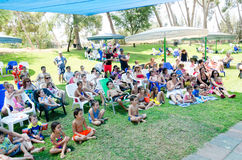 Omer, ISRAEL -Children and parents - the audience summer performances in the pool on the grass, July 25, 2015 Stock Photography