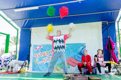 Free Omer, ISRAEL -The Man - A Clown Juggling On Stage With A White Poodle And Two Assistant, July 25, 2015 Royalty Free Stock Photos - 57187388