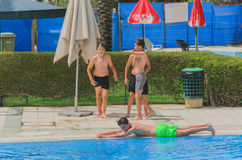 Omer, Negev, ISRAEL -June 27, A teenaged boy in outdoor summer swimming pool , 2015 in Israel. Omer, Negev, ISRAEL -June 27, A teenaged boy in outdoor summer Royalty Free Stock Photo