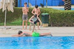 Omer, Negev, ISRAEL -June 27, A teenaged boy in outdoor summer swimming pool- 2015 in Israel. Omer, Negev, ISRAEL -June 27, A teenaged boy in outdoor summer Stock Photography