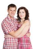 Omfamna den unga mannen och kvinnan arkivbild