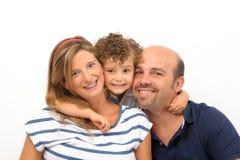 omfamnad familj Arkivbilder