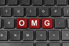 OMG或哎呀在键盘的词 免版税库存照片