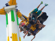 OMG I am Upside Down. A woman clutches her hands to her mouth as she is inverted and swung through the air on an amusement park ride at the 2014 Wisconsin State Royalty Free Stock Photo