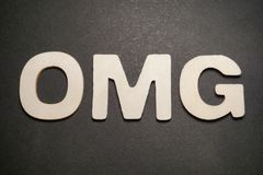 Omg. Oh my god expression in white letters on black background text illustration graphic type graphic design stock photo