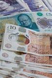 Omhoog gesloten van verschillende pond Sterlingbankbiljetten stock afbeeldingen