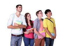 Omhoog kijken de groeps gelukkige studenten Stock Foto