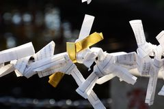 `Omikuji` sacred lot which a fortune. In Japan ,sacred lot which a fortune called `Omikuji` is written,after reding is ties in the place prepared in the shrine stock photo