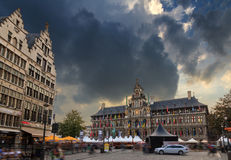 Ominous Antwerp. Ominous clouds Antwerp city hall at the great market square Grote Markt in Belgium on a stormy summer day Royalty Free Stock Photos