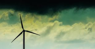 Ominous Clouds above a windmill. Cloudy day in Belgium... rain coming royalty free stock photos