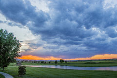 Ominous clouds. Beautiful sunset in front of a golf course royalty free stock images