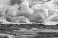 Ominous Clouds Over the Alaska Range in Denali National Park. A black and white photograph shows off the massive clouds building up over the Alaska Range of stock photo