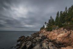 Ominous clouds over Bass Harbor Lighthouse. Dark rain clouds pass over Bass Harbor Light in Acadia National Park stock photos