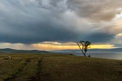 Ominous clouds over the island Olkhon. Lake Baikal royalty free stock photos