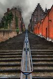 Ominous clouds staircase Liege. Beautiful cityscape of the 374-step long staircase Montagne de Bueren, a popular landmark and tourist attraction in Liege royalty free stock photos