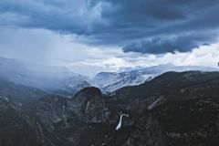 Yosemite National Park thunderstorm mountains. Ominous dark cloudy sky over mountains in Yosemite National Park with royalty free stock photography