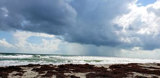 Ominous. Dark threatening clouds moving in stock photo