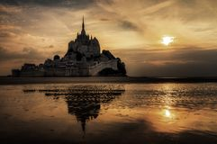 Ominous darkness at Le Mont Saint-Michel. Beautiful view of historic landmark Le Mont Saint-Michel in Normandy, France, a famous UNESCO world heritage site and stock image