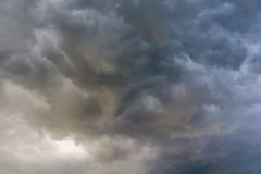 Ominous Grey Storm Clouds. Dramatic stormy black sky clouds before rain Stock Photos