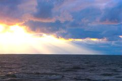 Ominous Lake Michigan. I was sitting on the shore of Lake Michigan here in Covert, Michigan, this summer waiting for the evening'show' to begin. And the angry stock photo