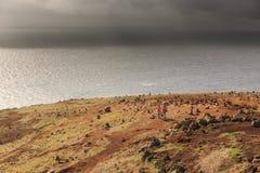Ominous landscape hike Madeira. Senior tourists hiking at the coastline cliffs at Ponta de Sao Lourenco on the east coast of Madeira island, with the atlantic stock photos