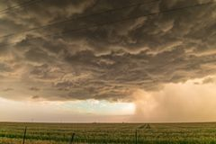 Threatening storm clouds with distinct rain and hail streaks over the high plains of northwestern Texas. Dramatic looking thunderstorm over the wide and open stock photos