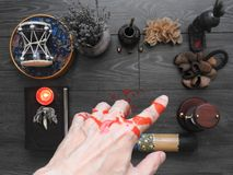 An ominous mystical ritual. The hand of the magician. Occultism. Divination. The Concept Of Halloween. Black magic.  stock images