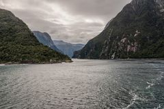 An Ominous Passageway through Milford Sound. Photo of a dark passageway through the mountains of Milford Sound stock photography