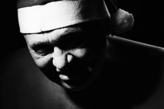 Ominous Santa Claus. Close up black and white portrait of gloomy and scary mature man in Santa Claus hat Stock Photography