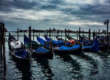 Ominous Skies over Venice and it`s Gondolas stock photos