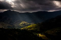 Ominous Sky above the Mountains. After a big disappointing sunrise the clouds decided to give a path to release the light for few minutes - Les Albères royalty free stock images