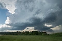 Two rotating wall clouds of a severe supercell thunderstorm stock photos