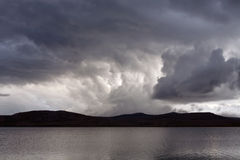 Ominous sky over the lake. Stock Photo