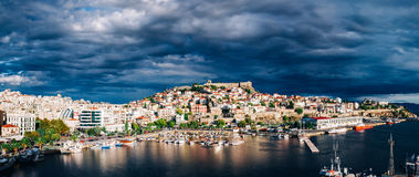 Ominous sky under the city. The city of Kavala, Greece under a dramatic sky stock images