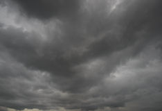 Ominous storm clouds. Background of storm clouds before a thunderstorm royalty free stock photography