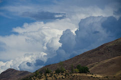 Ominous Storm Clouds Descending on Hells Canyon. Dark Storm Clouds Descending on Hells Canyon stock photography