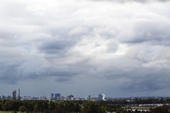 Ominous Stormclouds over Parramatta City Skyline, Sydney, Austra. Ominous and foreboding blue grey storm clouds moving in over the Parramatta city skyline and Stock Photos