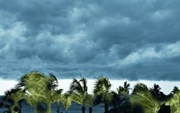 An ominous stormfront encroaches on the peaceful afternoon at the the beach royalty free stock photography
