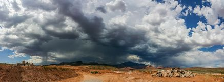 Ominous Stormy Sky and Cumulus Clouds with Rain Pano in the Dese. Rt Royalty Free Stock Photo