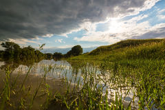 Ominous stormy sky over natural river. In spring royalty free stock photos