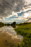 Ominous stormy sky over natural river. In spring stock image