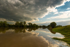 Ominous stormy sky over natural river. In spring royalty free stock photography