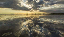 Ominous stormy sky reflection over natural lake. In the Danube Delta stock photography