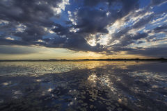 Ominous stormy sky reflection over natural lake. In the Danube Delta royalty free stock photography