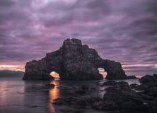 Ominous sunset at Pena Furada Stock Photos